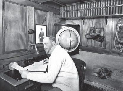 Douglas Mawson in his cabon on 'Discovery', BANZARE, 1929